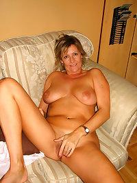 Mature slut pleasing herself in the sauna
