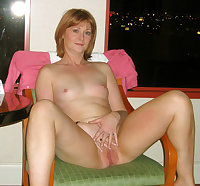 Mature slut riding a dildo on her couch