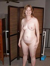 Mature masturbates with a large electronic dildo