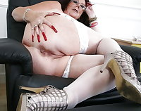 Plump mature is pleasing herself with a dildo